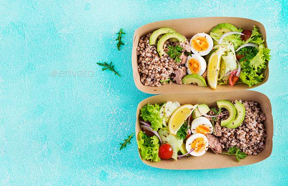 Buckwheat porridge, sliced tuna, boiled egg and fresh vegetable salad - Stock Photo - Images