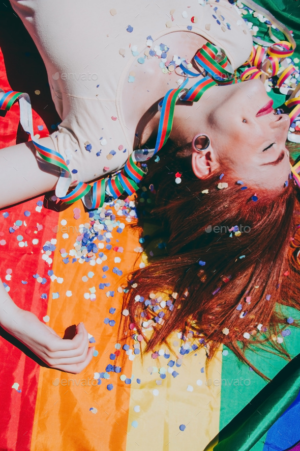 Young redhead woman celebrating gay pride day - Stock Photo - Images