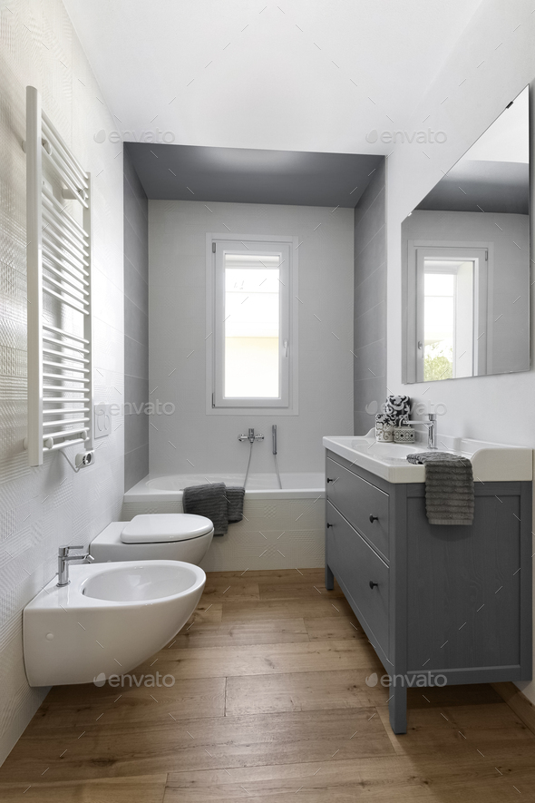 Interiors of a Modern Bathroom With Wood Floor - Stock Photo - Images
