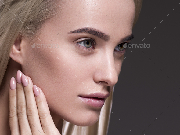 Natural make up blond hair woman close up face beauty portrait - Stock Photo - Images