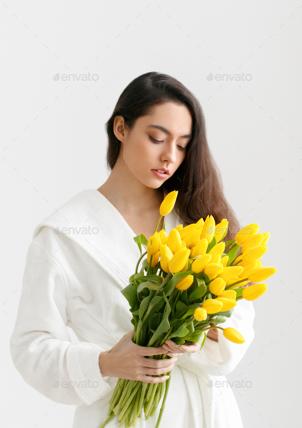 Tulips woman flower yellow tulip female portrait - Stock Photo - Images