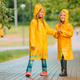 Adorable little girls under the rain on warm spring day - PhotoDune Item for Sale