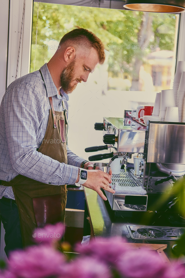 Redhead bearded guy pouring coffee. - Stock Photo - Images