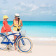 Family with a bike on tropical beach - PhotoDune Item for Sale