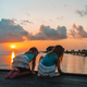 Adorable little girls on the beach at sunset - PhotoDune Item for Sale