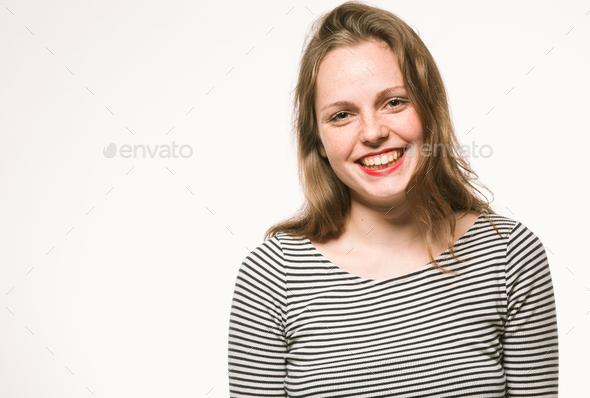 Woman portrait in stripes dress studio on white - Stock Photo - Images