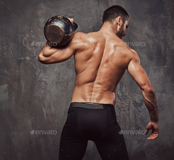 Brutal athletic bearded shirtless male doing exercise - Stock Photo - Images
