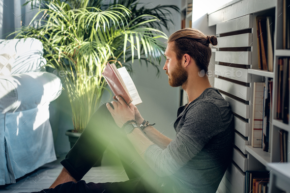 A man reading a book. - Stock Photo - Images