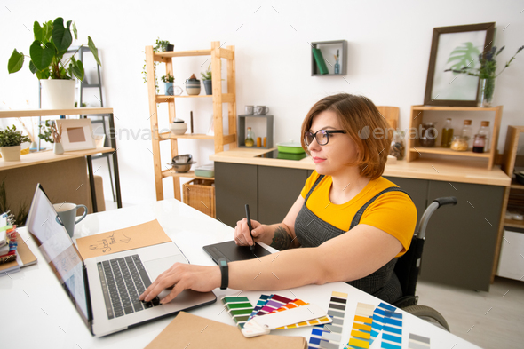 Using tablet while working on graphic design - Stock Photo - Images