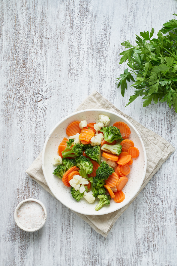 Mix of boiled vegetables. Broccoli, carrots, cauliflower. Steamed vegetables - Stock Photo - Images