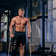 Shirtless bodybuilder on crutches near cross fit stand. - PhotoDune Item for Sale