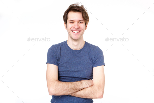 confident man standing with arms crossed by white background - Stock Photo - Images