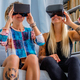 Two females having fun with virtual reality glasses. - PhotoDune Item for Sale