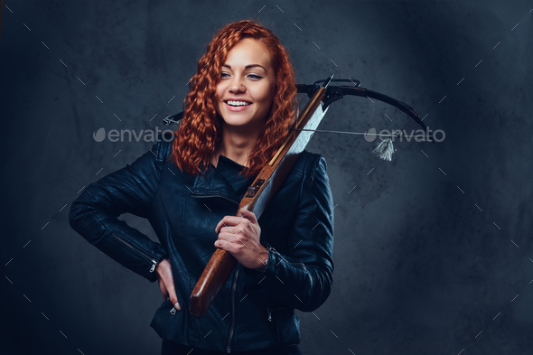 Redhead female  holds crossbow. - Stock Photo - Images