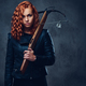 Redhead female  holds crossbow. - PhotoDune Item for Sale