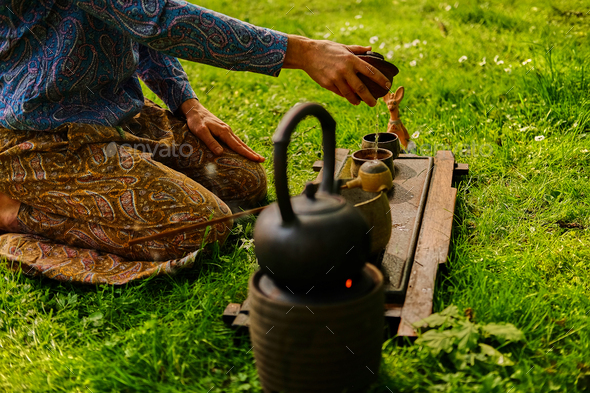 Chinese tea ceremony in a park. - Stock Photo - Images