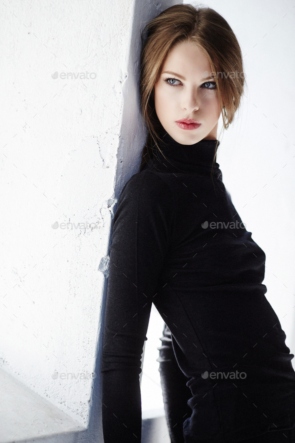 Glamour female model with short brown hair. - Stock Photo - Images