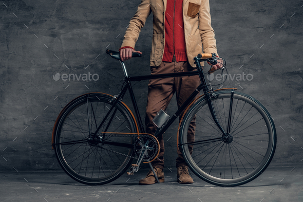 A man posing with single speed bicycle - Stock Photo - Images