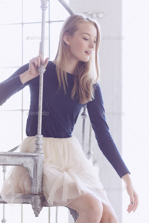 Blond female in a white scirt. - Stock Photo - Images