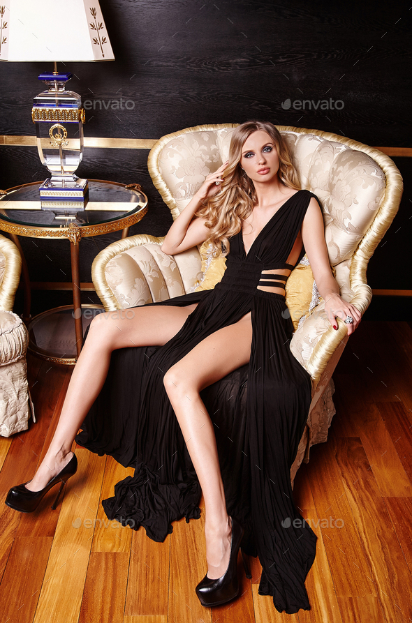 Luxury blond woman in a black dress. - Stock Photo - Images