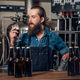A man manufacturer tasting beer in the microbrewery. - PhotoDune Item for Sale