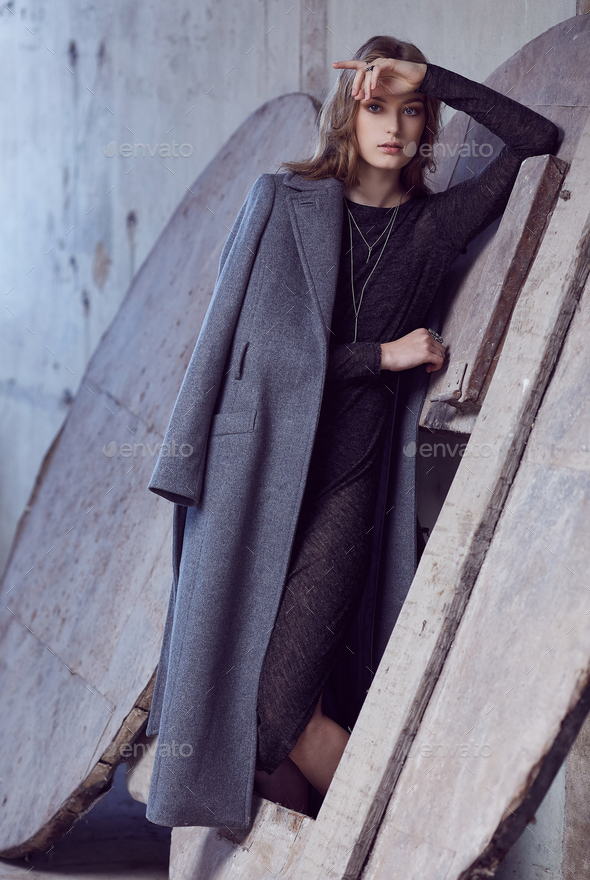 A woman in a grey coat. - Stock Photo - Images