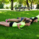 Females warming up on a lawn in summer park. - PhotoDune Item for Sale