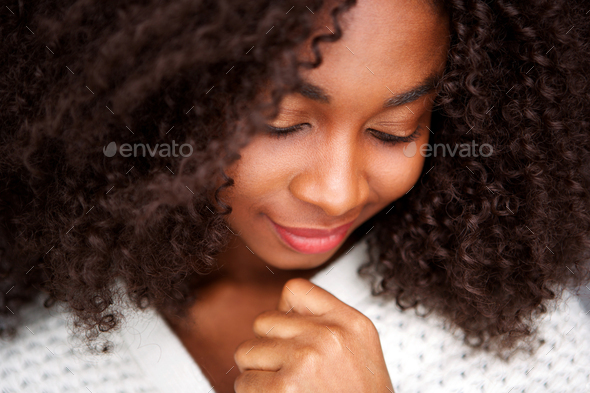 Close up young african woman with eyes closed - Stock Photo - Images