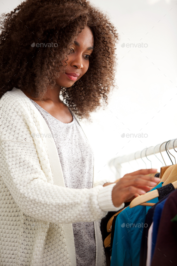 young african woman shopping for clothes - Stock Photo - Images