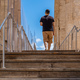 Athens Greece. Young man leaving Acropolis, wooden stairs and covid 19 protective measures - PhotoDune Item for Sale