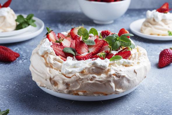 Cake Pavlova with meringue, strawberry and cream - Stock Photo - Images