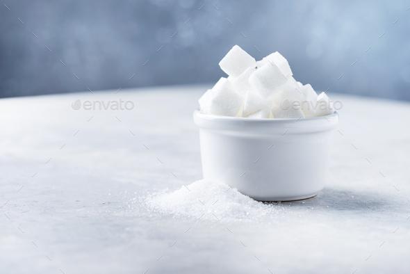 Sugar cubes and grain of sugar - Stock Photo - Images