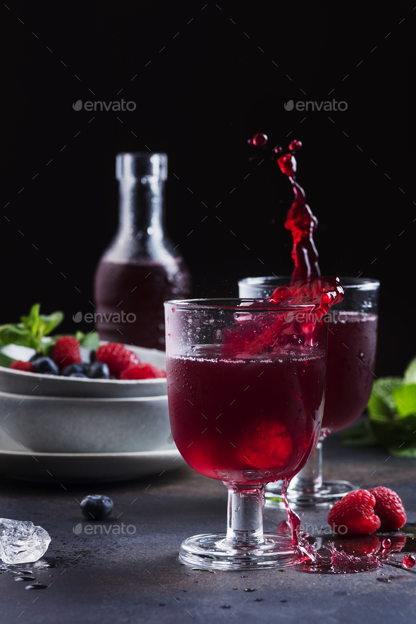 Glasses of a red berry juice - Stock Photo - Images