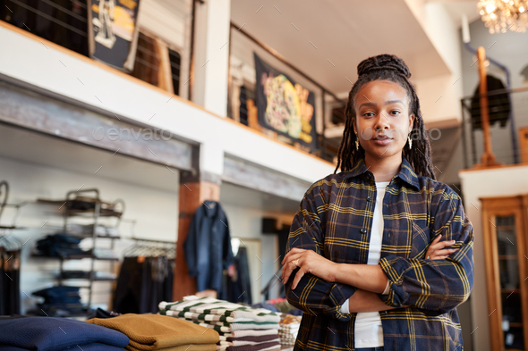 Portrait Of Female Owner Of Fashion Store Standing In Front Of Clothing Display - Stock Photo - Images