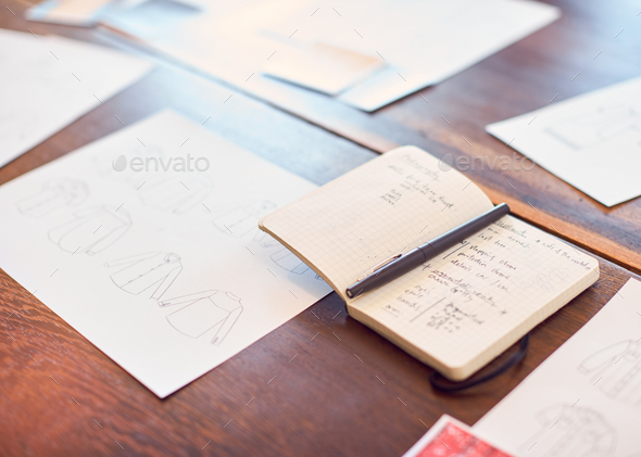 Drawings And Swatches Laid Out On Table For Creative Team Meeting - Stock Photo - Images