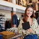 Portrait Of Female Owner Of Fashion Store Using Digital Tablet To Check Stock In Clothing Store - PhotoDune Item for Sale