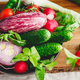 Different fresh vibrant vegetables in a plate on a wooden tray. - PhotoDune Item for Sale