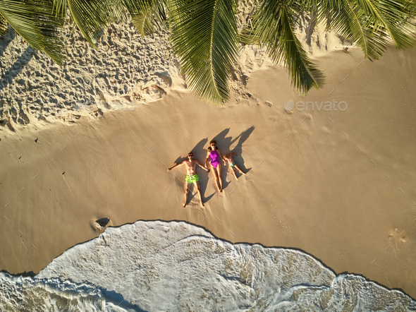 Family on beach at Seychelles aerial top view - Stock Photo - Images