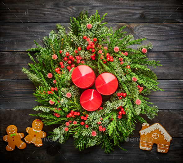 Christmas wreath and candles on wooden background - Stock Photo - Images