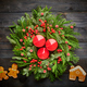 Christmas wreath and candles on wooden background - PhotoDune Item for Sale