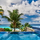Beach with resort swimming pool at Seychelles - PhotoDune Item for Sale