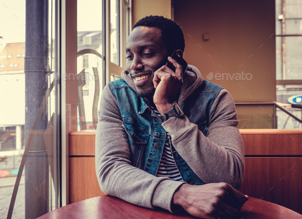 A  man talking on smartphone. - Stock Photo - Images