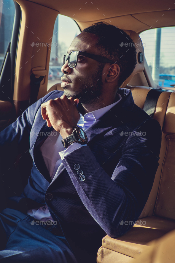 Stylish black man in a car. - Stock Photo - Images