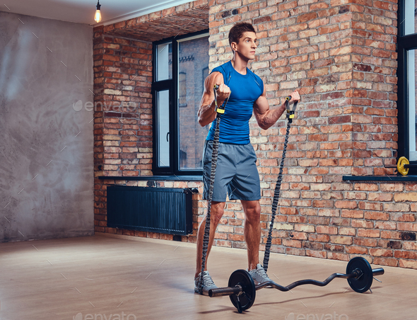 A man holds barbell. - Stock Photo - Images