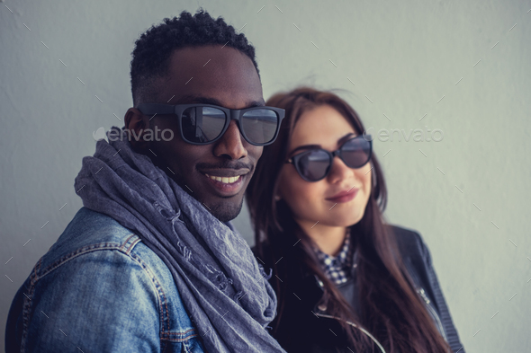 Portrait of afro american guy with caucasian female. - Stock Photo - Images