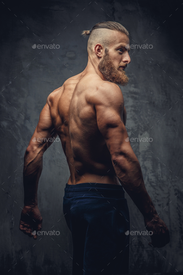 Shirtless muscular man with beard from his back. - Stock Photo - Images
