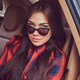 Portrait of a Caucasian woman in a flannel shirt and sunglasses - PhotoDune Item for Sale