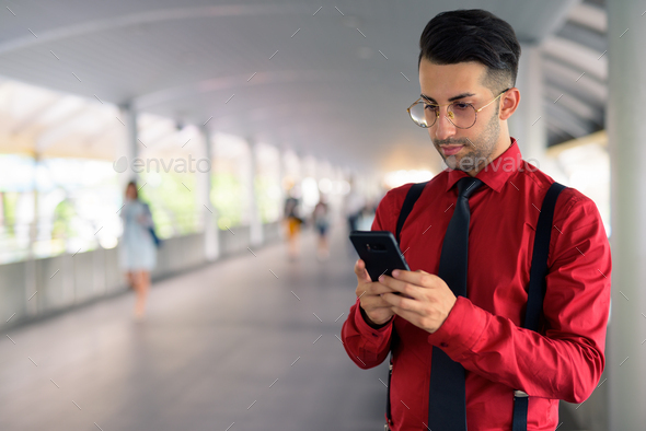 Young handsome Persian businessman exploring the city - Stock Photo - Images