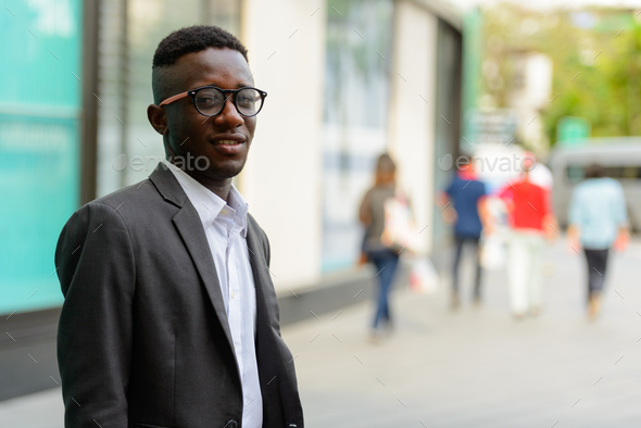 Young African businessman in the city outdoors - Stock Photo - Images