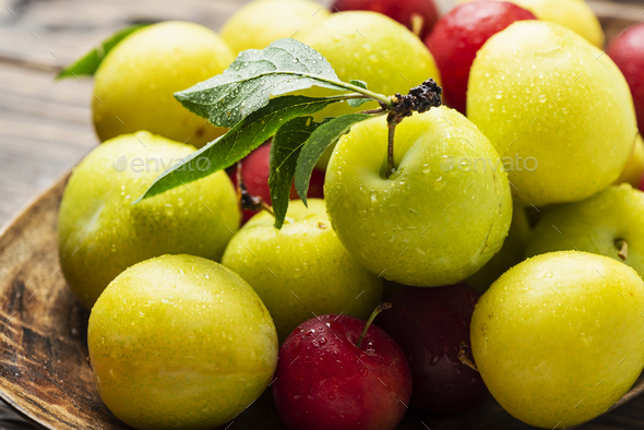 Fresh sweet plums on the wooden table - Stock Photo - Images